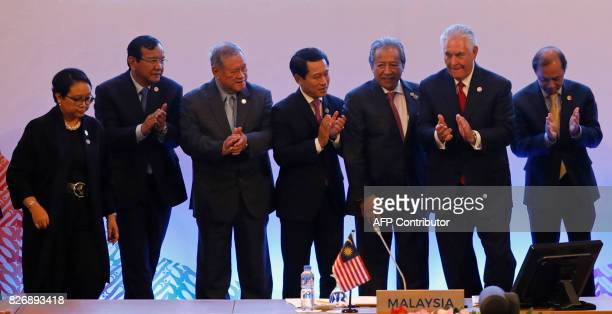 US Secretary of State Rex Tillerson applauds with Association of Southeast Asian Nations foreign ministers as they take part in the ASEANUS...