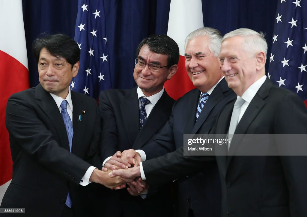 Secretary of State Rex Tillerson (2ndR), Defense Secretary James Mattis (R), shake hands with Japanese Foreign Minister Taro Kono (2ndL) and Defense Minister Itsunori Onodera (L), during a meeting of the U.S.-Japan Security Consultative Committee at the State Department, on August 17, 2017 in Washington, DC.