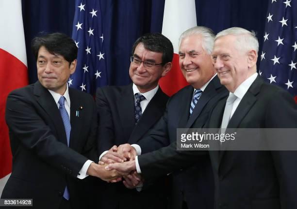 Secretary of State Rex Tillerson Defense Secretary James Mattis shake hands with Japanese Foreign Minister Taro Kono and Defense Minister Itsunori...