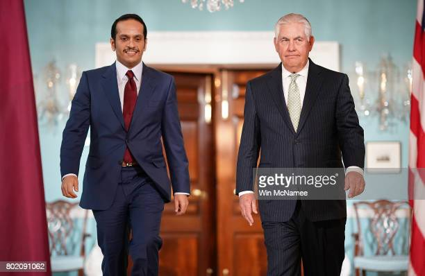 S Secretary of State Rex Tillerson escorts Qatari Foreign Minister Sheikh Mohammed Bin Abdulrahman Al Thani prior to a scheduled meeting at the State...