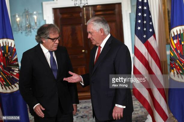 S Secretary of State Rex Tillerson extends his hand for a hand shake with Organization of American States Secretary General Luis Almagro at the State...