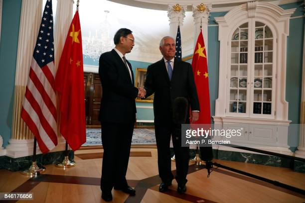 US Secretary of State Rex Tillerson greets Chinese State Councilor Yang Jiechi at the State Department September 12 2017 in Washington DC Tillerson...