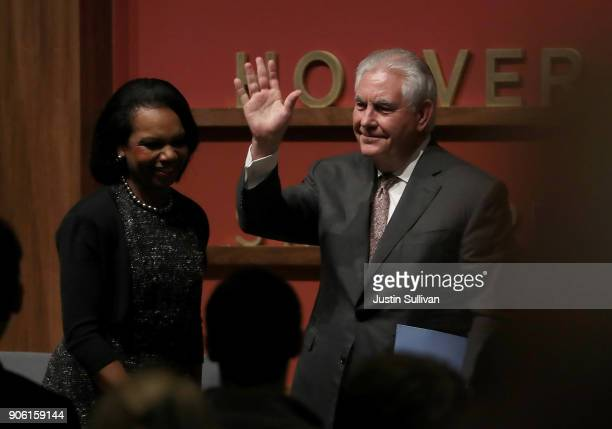 S Secretary of State Rex Tillerson greets former US Secreatry of State Condoleezza Rice and the audience as he speaks to the Hoover Institution and...