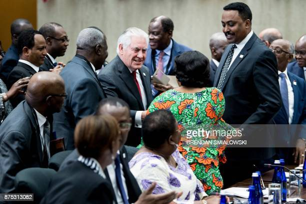 US Secretary of State Rex Tillerson greets participants during a meeting of African leaders at the State Department on November 17 2017 in Washington...