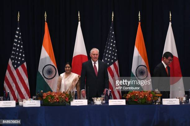 US Secretary of State Rex Tillerson India's Foreign Minister Sushma Swaraj and Japan's Foreign Minister Taro Kono arrive for a meeting on the...