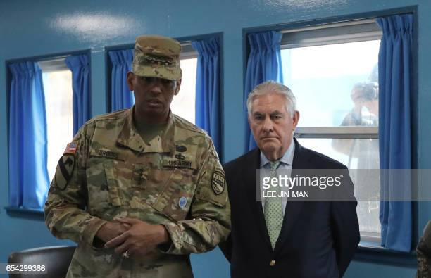 US Secretary of State Rex Tillerson is briefed by US Gen Vincent K Brooks commander of the United Nations Command Combined Forces Command and United...