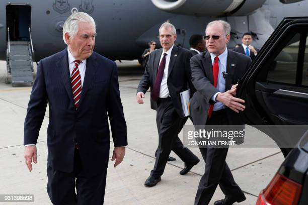 Secretary of State Rex Tillerson is shown to his car as he arrives at Jomo Kenyatta International Airport in Nairobi on March 9 2018 US President on...
