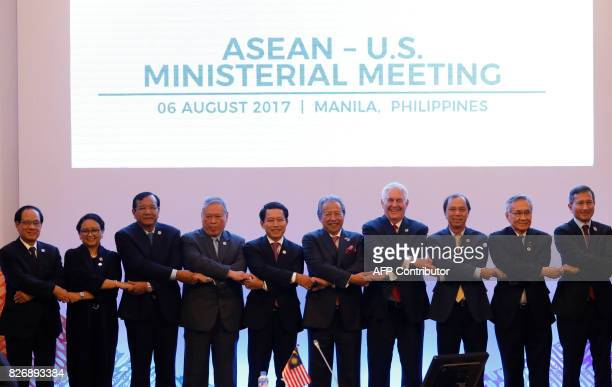 US Secretary of State Rex Tillerson link arms with Association of Southeast Asian Nations foreign ministers and their representatives as they take...