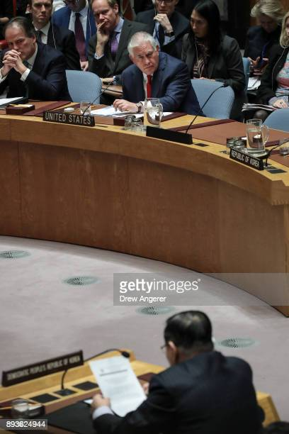 US Secretary of State Rex Tillerson listens as North Korea's ambassador to the United Nations Ja Songnam speaks during a United Nations Security...