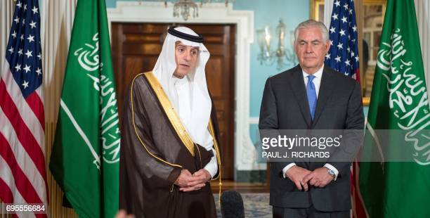 US Secretary of State Rex Tillerson listens as Saudi Foreign Minister Adel alJubeir delivers brief remarks to the media on June 13 shortly before...