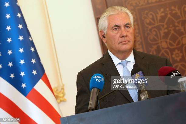 US Secretary of State Rex Tillerson listens looks on during a press conference in Doha on July 11 2017 The US and Qatar announced they have signed an...