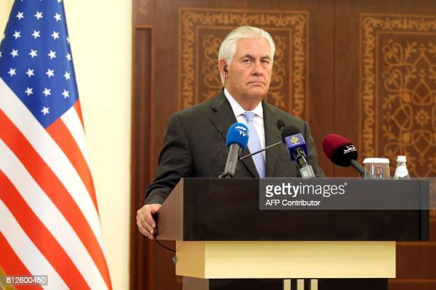 US Secretary of State Rex Tillerson listens to questions by journalists during a press conference in Doha on July 11 2017 The US and Qatar announced...