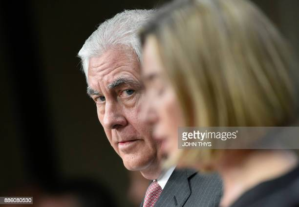 US Secretary of State Rex Tillerson looks on next to EU foreign policy chief Federica Mogherini during a joint press conference at the European Union...