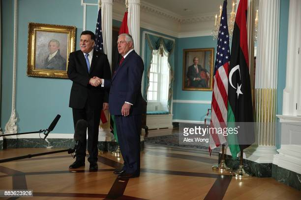 S Secretary of State Rex Tillerson participates in a photo op with Libyan Prime Minister Fayez alSarraj at the State Department December 1 2017 in...