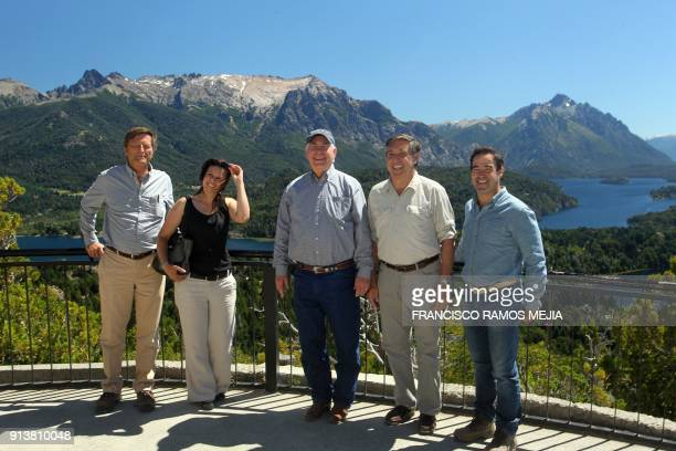 Secretary of State Rex Tillerson poses for pictures with the president of National Parks Eugenio Brear , the vice-president of National Parks...