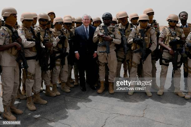 US Secretary of State Rex Tillerson poses with Chadian Special Program for Embassy Augmentation and Response security personnel as he departs...