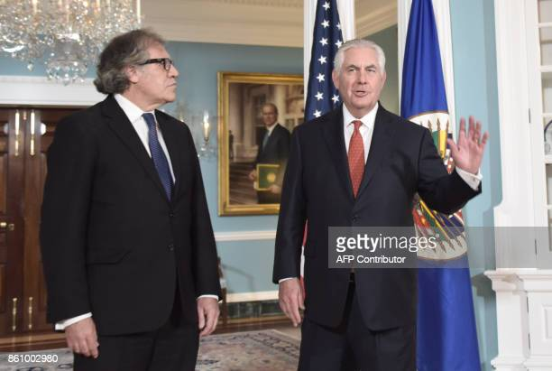 US Secretary of State Rex Tillerson poses with Organization of American States Secretary General Luis Almagro before their meeting on October 132017...