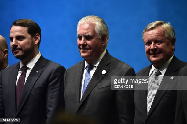 US Secretary of State Rex Tillerson poses with President of the World Petrolium Council Jozsef Toth and Turkish Energy Minister Beraat Albayrak...