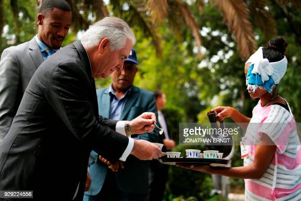 US Secretary of State Rex Tillerson receives a cup of brewed coffee during a traditional coffee ceremony at the US embassy in Addis Ababa on March 8...