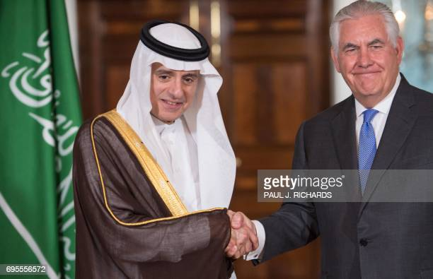 US Secretary of State Rex Tillerson shake hands with Saudi Foreign Minister Adel alJubeir on June 13 shortly before their private meeting at the US...