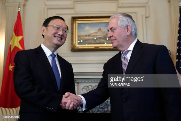 US Secretary of State Rex Tillerson shakes hands with Chinese State Councilor Yang Jiechi before their meeting at the State Department in...
