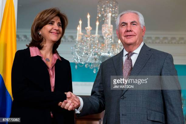 US Secretary of State Rex Tillerson shakes hands with Colombian Foreign Affairs Minister Maria Angela Holguin at the Department of State in...
