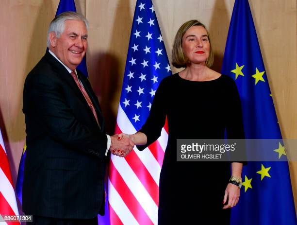 US Secretary of State Rex Tillerson shakes hands with EU foreign policy chief Federica Mogherini at the European Union Council building in Brussels...