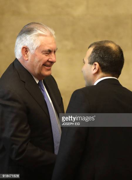 US Secretary of State Rex Tillerson shakes hands with Lebanese Foreign Minister Gebran Bassil at the presidential palace in Baadba on the outskirts...