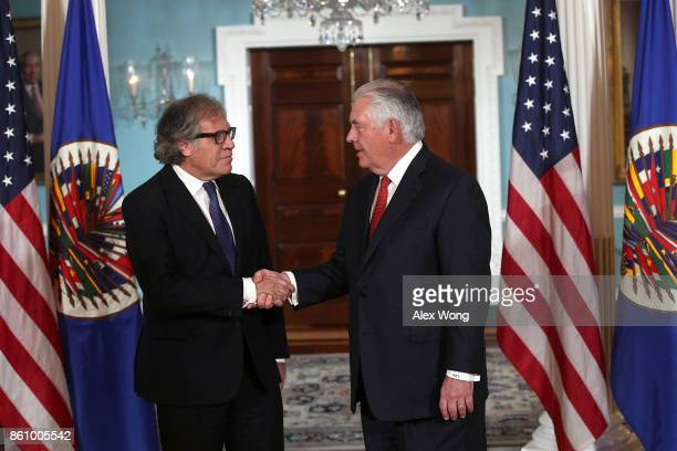 S Secretary of State Rex Tillerson shakes hands with Organization of American States Secretary General Luis Almagro at the State Department October...