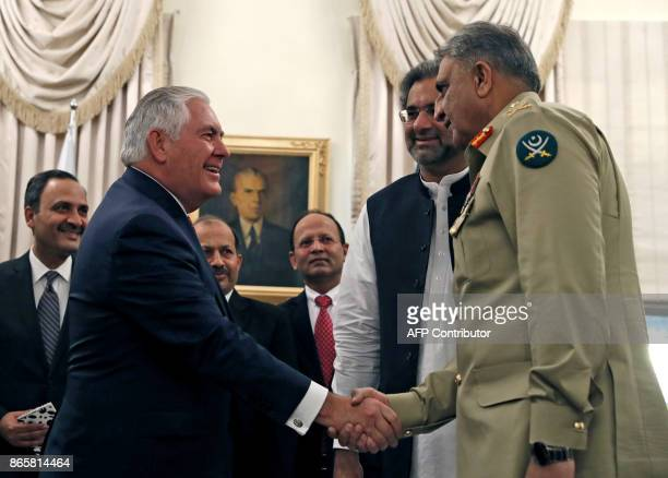 US Secretary of State Rex Tillerson shakes hands with Pakistani Chief of Army Staff Qamar Javed Bajwa as Pakistani Prime Minister Shahid Khan Abbas...