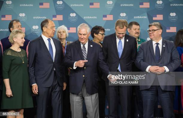 US Secretary of State Rex Tillerson shows the way out to Arctic Council foreign ministers from L to R Sweden's Margot Wallstrom Russia's Sergei...