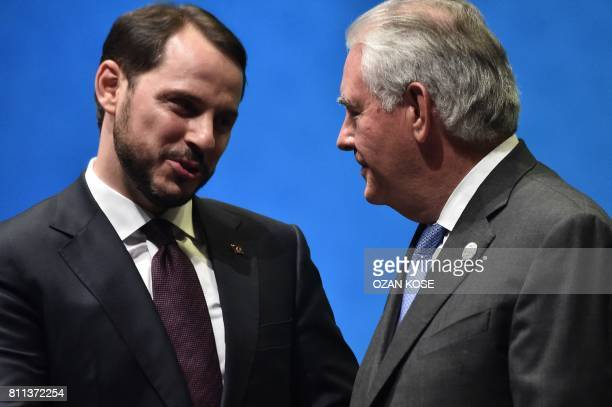US Secretary of State Rex Tillerson speaks to Turkish Energy Minister Beraat Albayrak during the 22nd World Petroleum Congress opening ceremony on...