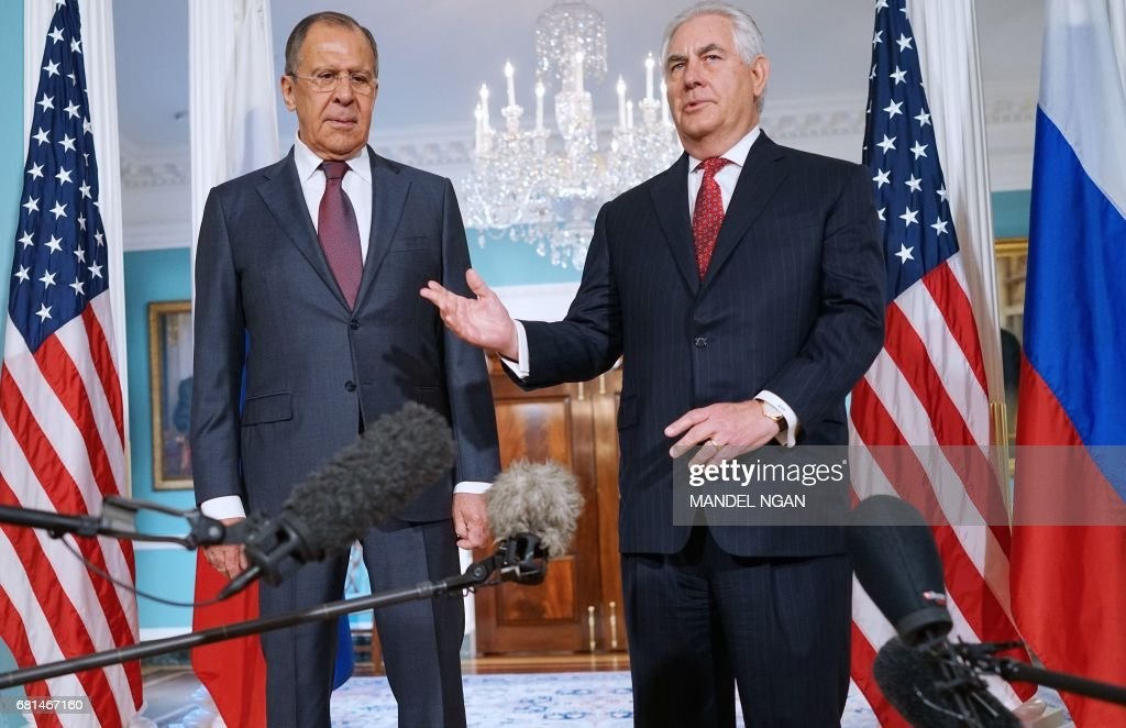US Secretary of State Rex Tillerson (R) speaks while posing for photos with Russian Foreign Minister Sergei Lavrov in the Treaty Room of the State Department in Washington, DC on May 10, 2017. /