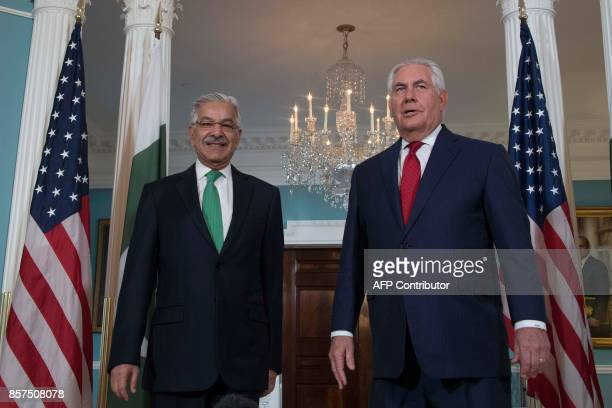 US Secretary of State Rex Tillerson speaks with Pakistani Foreign Minister Khawaja Muhammad Asif at the State Department in Washington DC October 4...