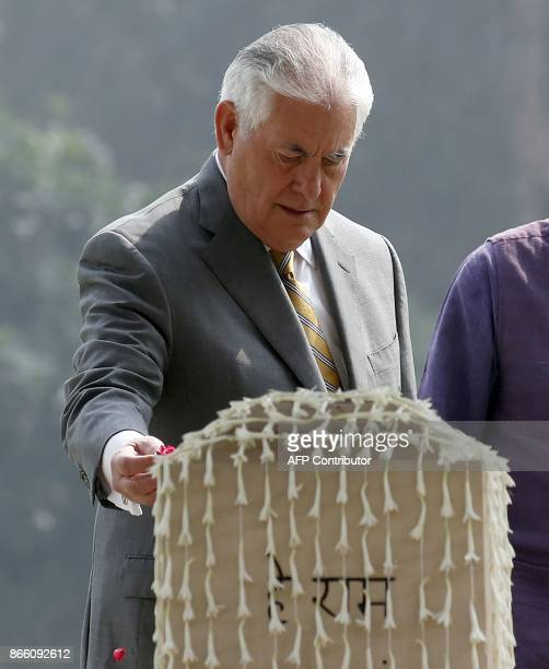 US Secretary of State Rex Tillerson sprinkles rose petals on the Martyr's Column the site of the 1948 assassination of Indian independence icon...