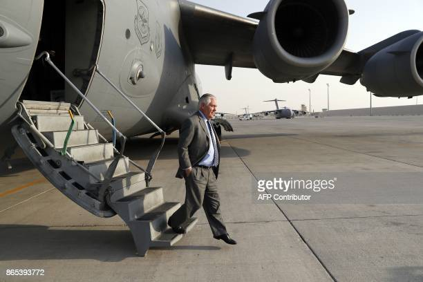 US Secretary of State Rex Tillerson steps off the plane as he arrives to AlUdeid Air Base in Qatar after his visit to Bagram Air Base in Afghanistan...