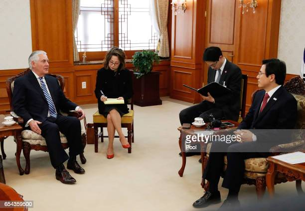 US Secretary of State Rex Tillerson talks with acting South Korean President and Prime Minister Hwang Kyoahn prior to their meeting at the government...