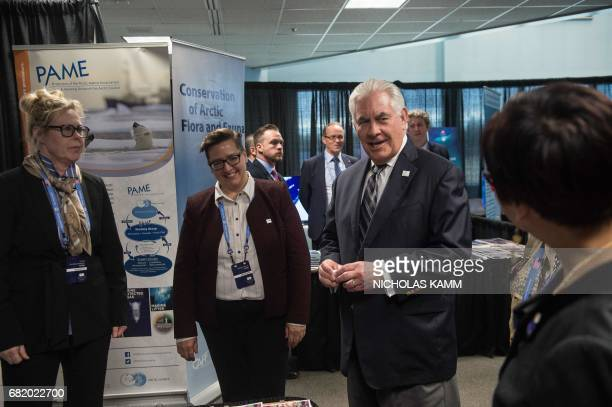 US Secretary of State Rex Tillerson visits a booth at the Working Group Exhibition at the Arctic Council meeting in Fairbanks Alaska on May 11 2017 /...