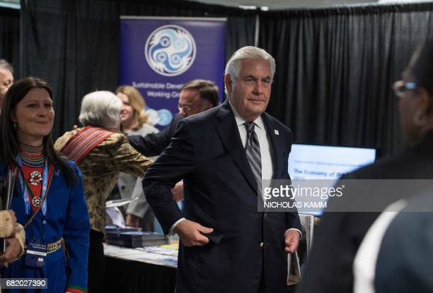 US Secretary of State Rex Tillerson visits the Working Group Exhibition at the Arctic Council meeting in Fairbanks Alaska on May 11 2017 / AFP PHOTO...