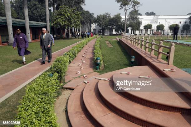 US Secretary of State Rex Tillerson walks next to the path of the last steps of Indian independence icon Mahatma Gandh to the Martyr's Column the...