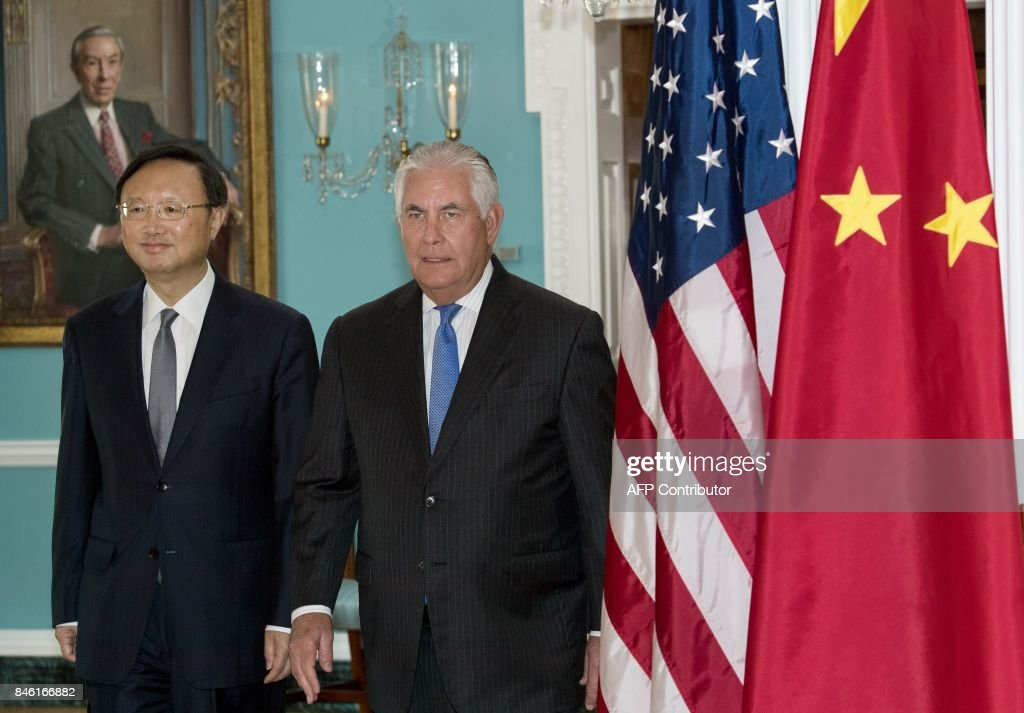 US Secretary of State Rex Tillerson(R) walks with Chinese State Councilor Yang Jiechi towards the Treaty Room for a photo opportunity shortly before their private meeting at the US Department of State September 12, 2017, in Washington, DC. /