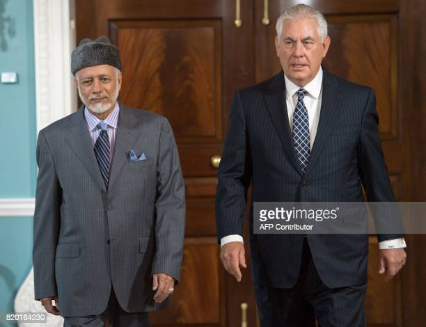 US Secretary of State Rex Tillerson walks with Foreign Minister of Oman Yusuf bin Alawibin Abdullah at the US Department of State to deliver brief...