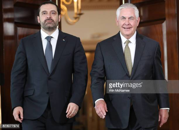 S Secretary of State Rex Tillerson walks with Lebanese Prime Minister Saad Hariri at the State Department July 26 2017 in Washington DC Tillerson and...