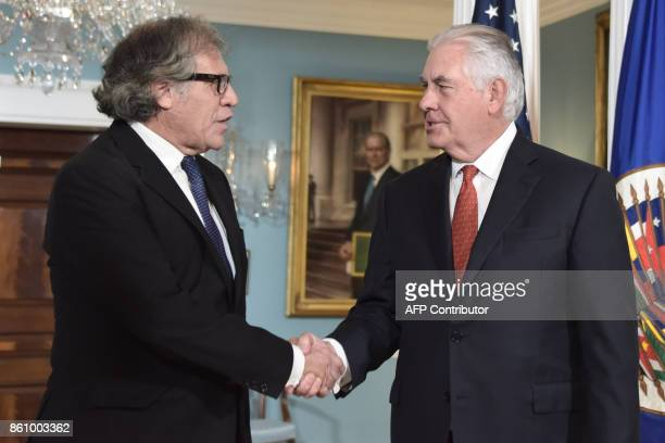 US Secretary of State Rex Tillerson welcomes Organization of American States Secretary General Luis Almagro before their meeting on October 132017 at...