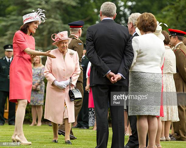 Secretary of state Theresa Villiers introduces Queen Elizabeth II to the Tánaiste Eamon Gilmore during a garden party held at Hillsborough Castle on...