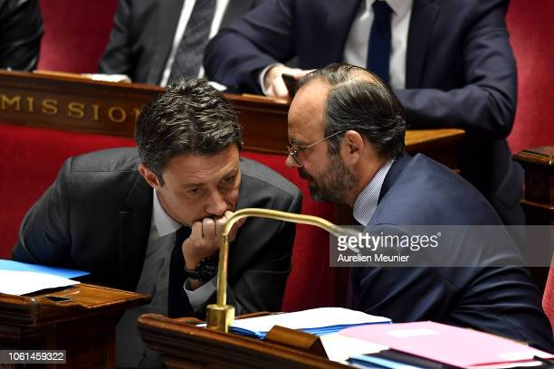Secretary of State to the Prime Minister and Government Spokesman Benjamin Griveaux speaks with French Prime Minister Edouard Philippe as ministers...