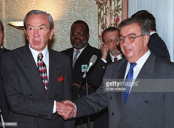 Secretary of State Warren Christopher shakes hands with Russian Foreign Minister Yevgeniy Primakov 23 September in New York. The two met on the...