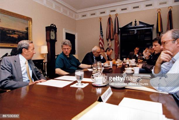 US Secretary of State Warren Christopher talks with American politician US President Bill Clinton during a cabinet meeting in the Roosevelt Room of...