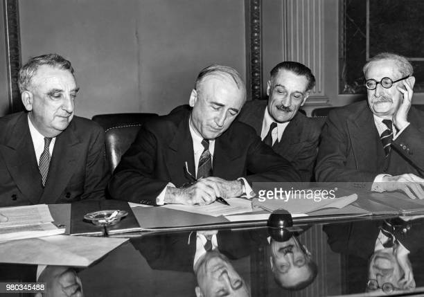 US secretary of States James F Byrnes flanked by US Secretary of the Treasury Fred M Vinson French ambassador to the US Henri Bonnet and...