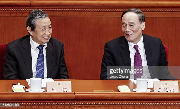 Secretary of the Central Commission for Discipline Inspection Wang Qishan talk with Chinese Vice President Ma Kai attends opening session of the...
